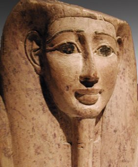 A Very Fine Egyptian Cedar Mummy Mask