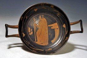 A Greek Attic Stemless Kylix Attributed To YZ Group