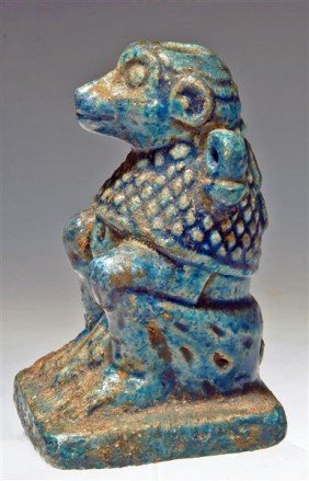 An Egyptian Glazed Composition Baboon Vessel