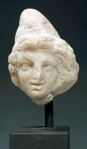 A Roman Marble Head Of Paris Or Ganymede
