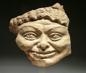 A Roman Terracotta Head Of Medusa