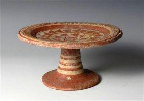 A Mesappian Pottery Pedestal Plate