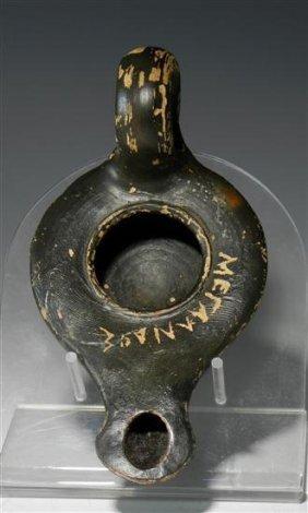 An Inscribed Greek Blackware Oil Lamp
