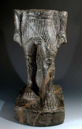An Egyptian Granite Torso - The Striding King
