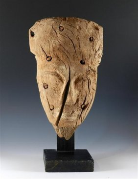 An Egyptian Wooden Mummy Mask