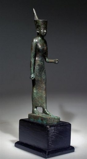 An Egyptian Bronze Statuette Of The Goddess Neith