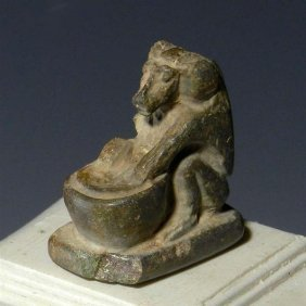An Egyptian Carved Stone Seated Baboon