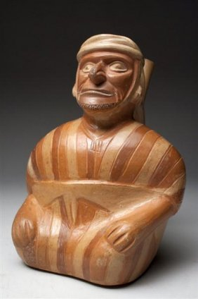 A Moche Seated Man In Striped Tunic