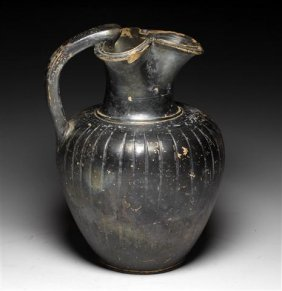 A Greek Gnathian Trefoil Ribbed Pitcher
