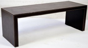 A TOBACCO FINISH LEATHER BENCH TABLE WITH BASEBALL S