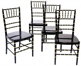 A SET OF FOUR BLACK ENAMELED AND GOLD TRIM FAUX BAM