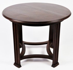 A ROUND ART AND CRAFT OAK TABLE