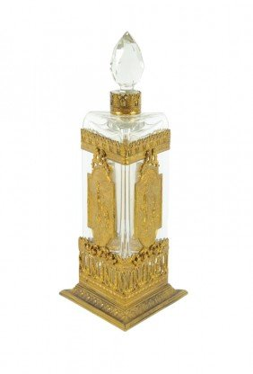 A LARGE GILT BRASS MOUNTED CRYSTAL PERFUME BOTTLE Ea