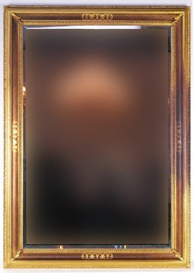 A LARGE GILT FRAME BEVELED MIRROR
