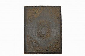 AN ITALIAN EMBOSSED AND TOOLED LEATHER DESK FOLIO L