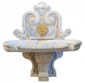 A DRAMATIC ITALIAN HAND-CARVED MARBLE AND STONE WAL