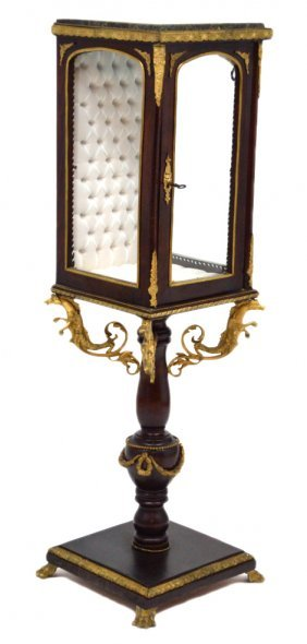 A FRENCH STYLE MAHOGANY AND ORMOLU DISPLAY CASE ON