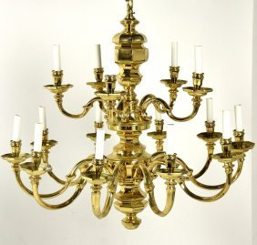 A 16 LIGHT DUTCH COLONIAL STYLE BRASS CHANDELIER