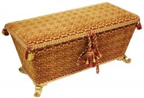AN ITALIAN STYLE FABRIC COVERED TRUNK