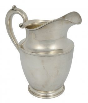 A WALLACE STERLING SILVER FOOTED PITCHER American, 2