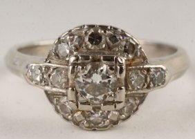 A Diamond Cluster Ring, Stamped '14K' To The White