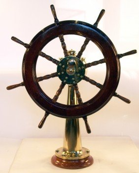 Ship's Wheel On Brass Pedestal.