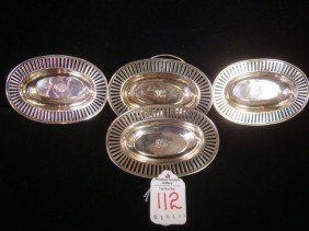 Four TIFFANY & CO Sterling Silver Oval Nut Dishes: