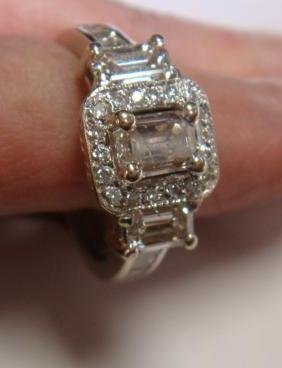 Lady's Emerald Cut Diamond And 14k White Gold Ring: