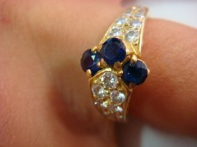 Lady's Blue Sapphire And Diamond 18kt Gold Ring: