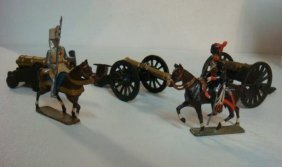 Three Cannons And Two Mounted 54mm Model Soldiers: