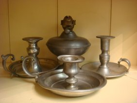 Three Pewter Candlesticks And An Oil Lamp: