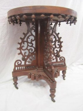 E33-7  ROUND CARVED PARLOR TABLE