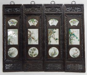 Four Chinese Carved Panels With Porcelain Plaques
