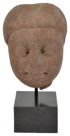 A Kushan Mottled Pink Sandstone Head Of Buddha,