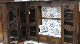 FRENCH PROVINCIAL OAK FOUR DOOR BIBLIOTHEQUE