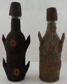 Pair Of Primitive Bark Covered Bottles