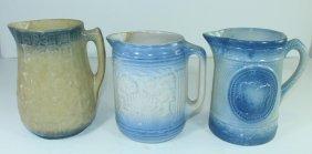 Three Blue And White Stoneware Pitchers