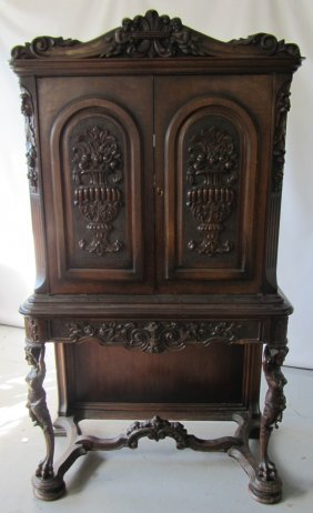C1900 Figural 2 Door Walnut Cabinet