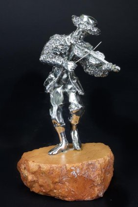 Silver Figure Of A Musician On A Stone Base