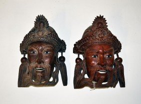 Two Asian Sculptural Masks