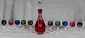 11 PC. CUT GLASS DECANTER SET. MULTI-COLOR GLASS BOWLS