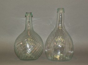2 Clear Blown Glass Bottles