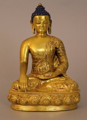Asian Buddha In Sitting Possition With One Hand With