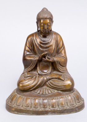 Asian Buddha In Sitting Possiton On Integrated Round