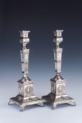 A PAIR OF LARGE SILVER CANDLESTICKS BY SZEKMAN