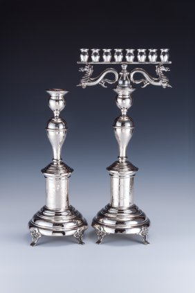 A PAIR OF SILVER CANDLESTICKS WITH MENORAH