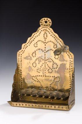 A BRASS SHEET METAL CHANUKAH LAMP. The Netherlands, 19t