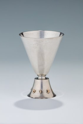 A Large Sterling Silver And Gold Kiddush Goblet.