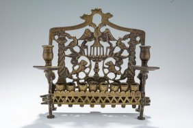 A Bronze Chanukah Lamp. Ukraine, 19th Century. On Four