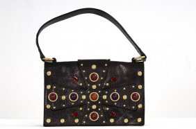 YVES SAINT LAURENT JEWELED LEATHER HANDBAG